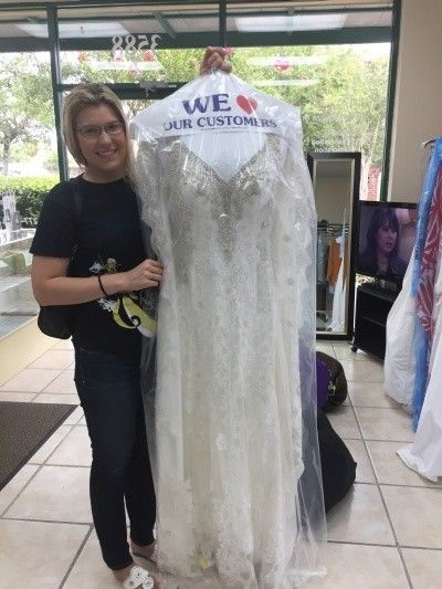 Bride Inspecting the gown after cleaning